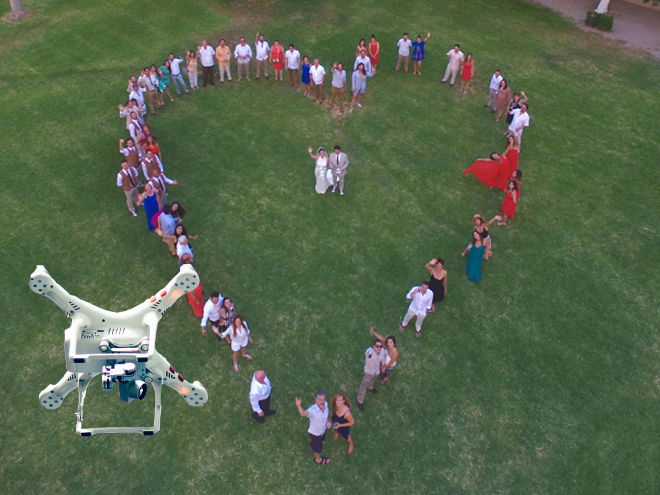Video Recording drone arial wedding party photo by clark stephen