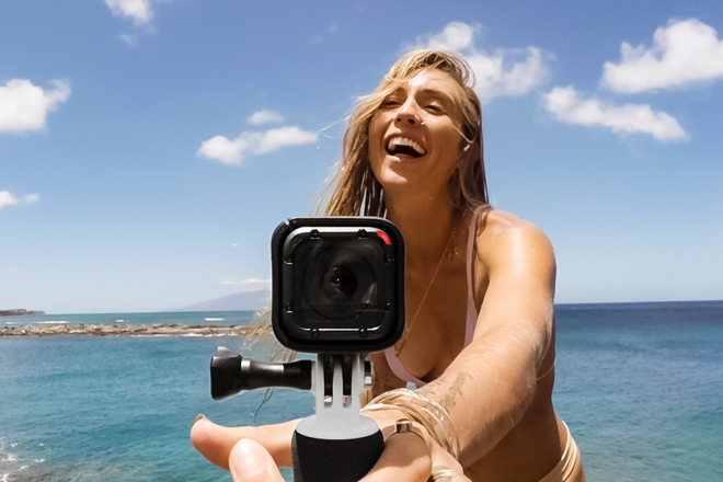 video recording go pro blonde at the beach