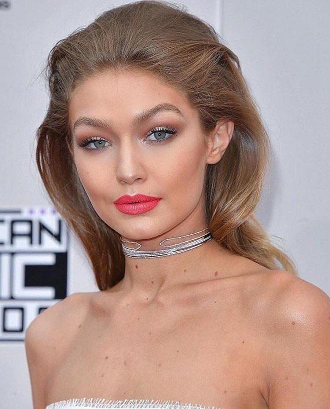 The 21 Best Gigi Hadid Makeup Looks Ever bold pink lipstick