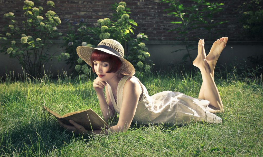 reading a book, hat, park